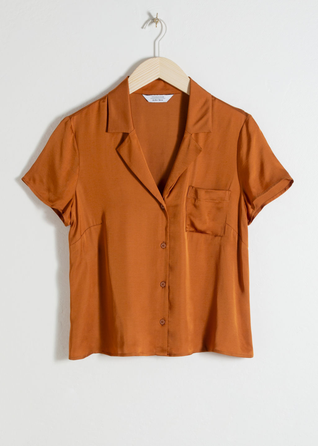 Front image of Stories relaxed fit satin shirt in orange