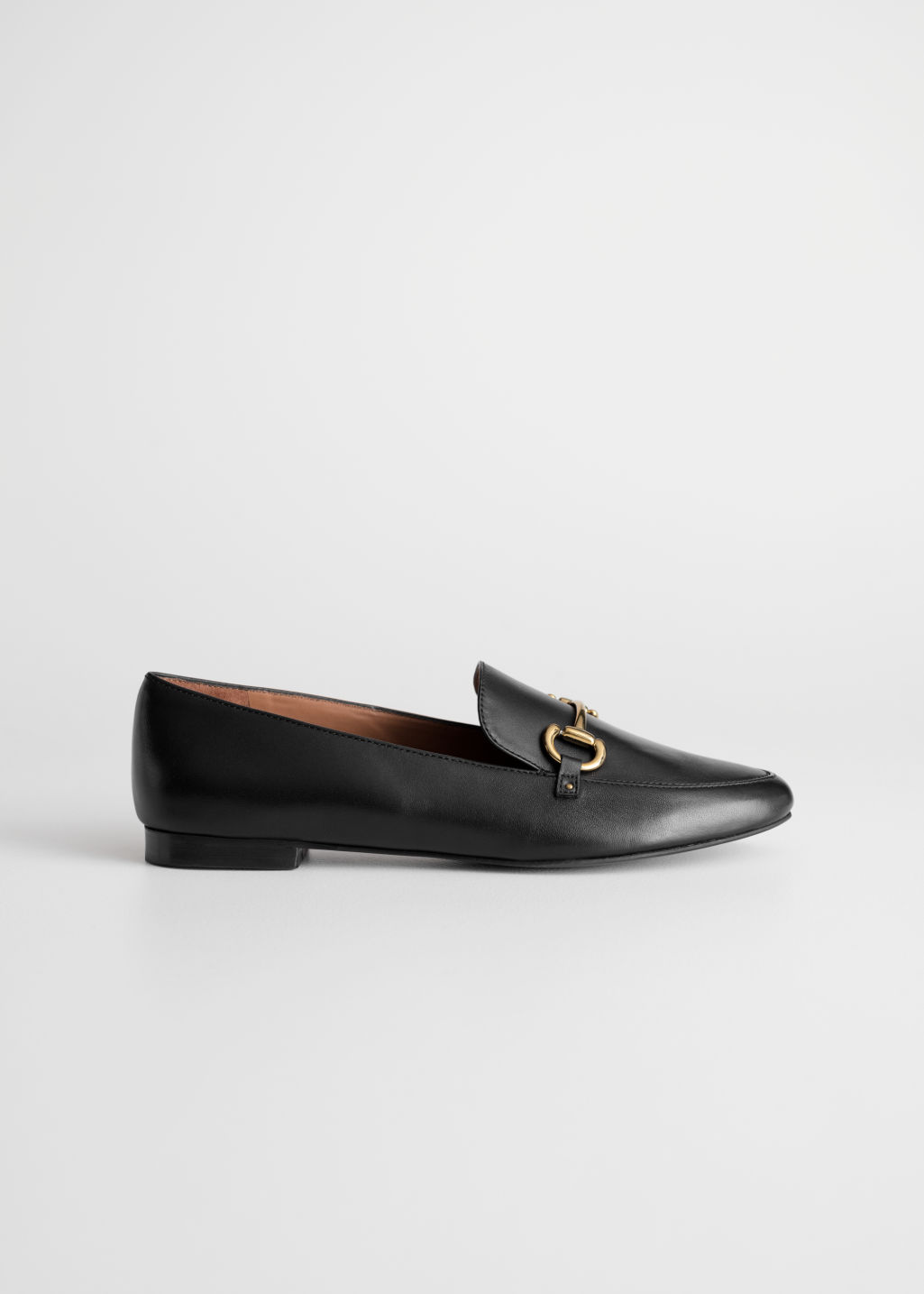Front image of Stories horsebit buckle loafers in black