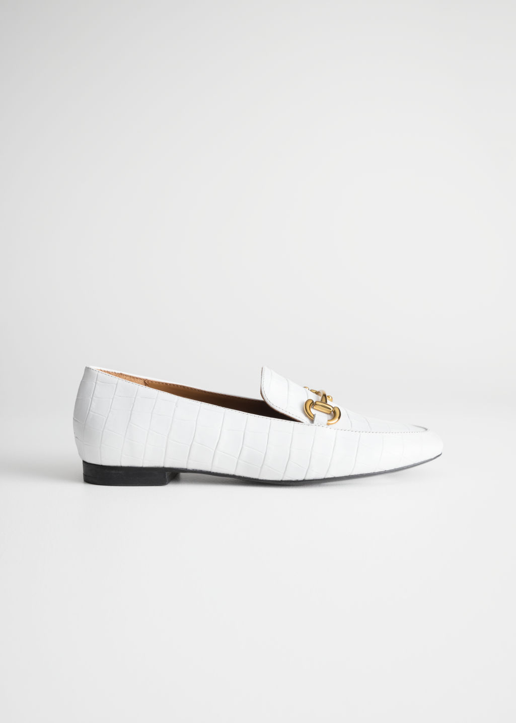 Front image of Stories equestrian buckle loafers in white