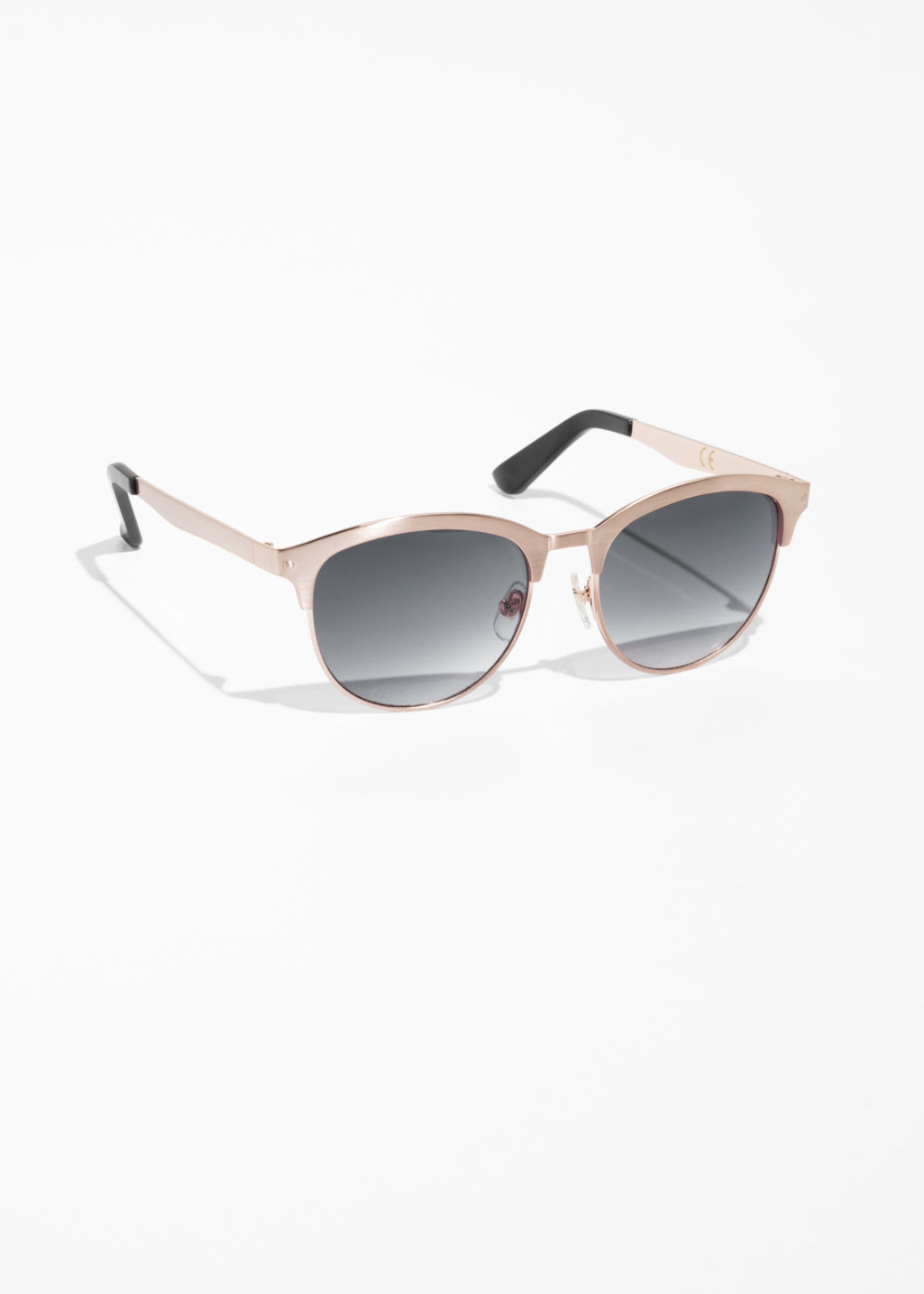 Front image of Stories brushed metal sunglasses in brown