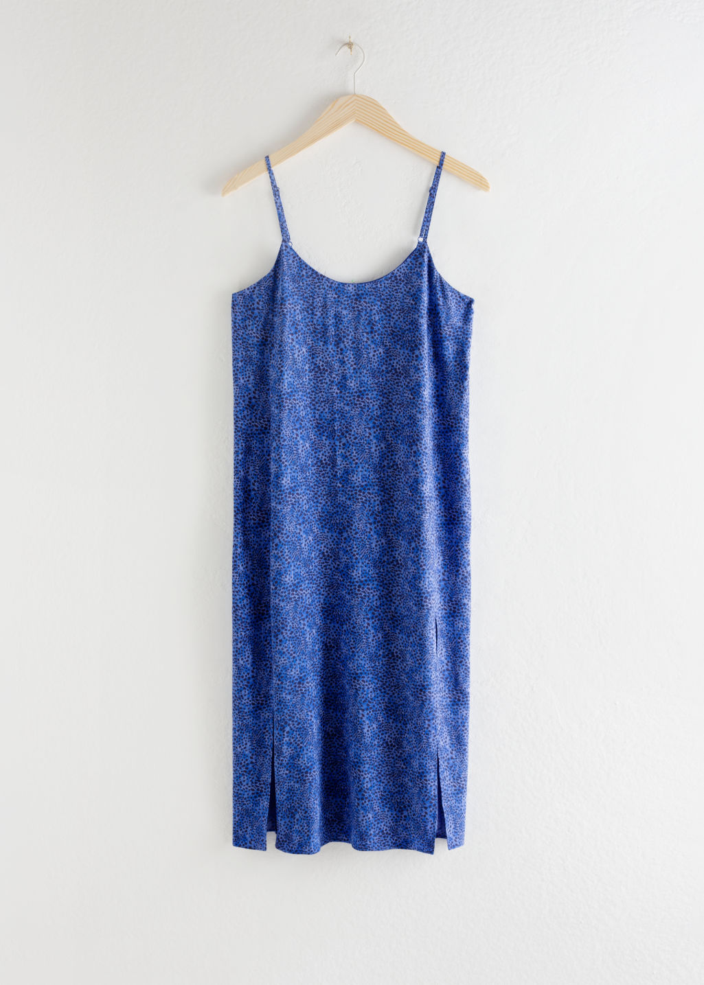 Front image of Stories v-cut dress in blue
