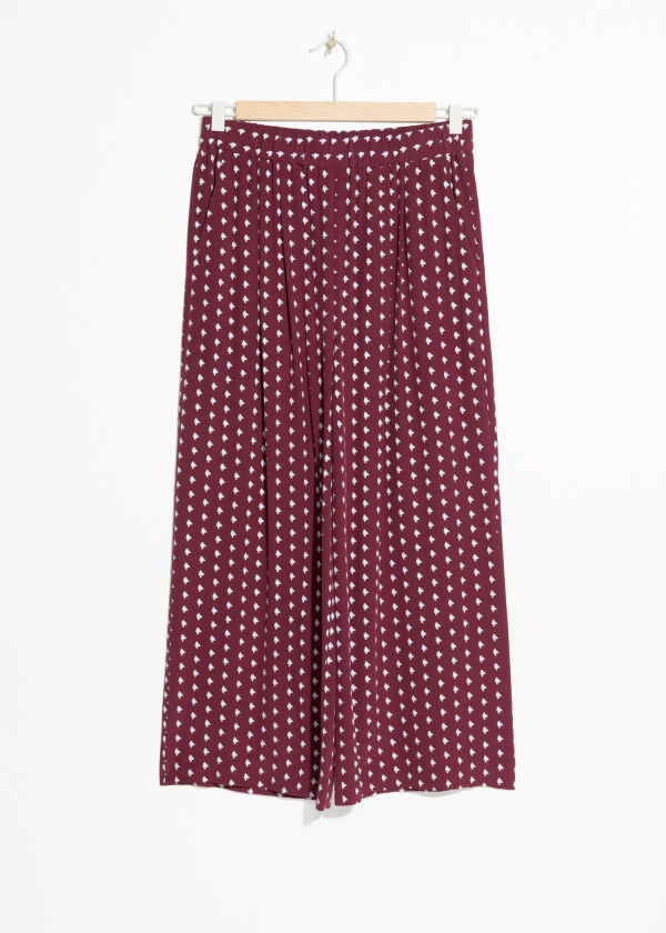 Front image of Stories printed culottes in red