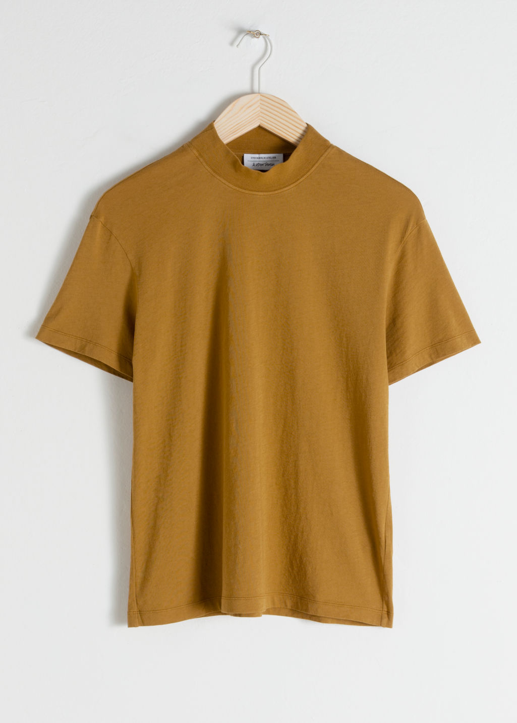 Front image of Stories mock neck tee in yellow