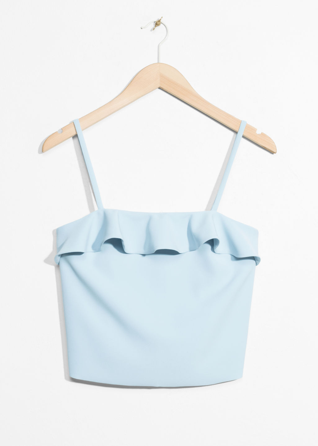 Front image of Stories ruffle crop top in turquoise