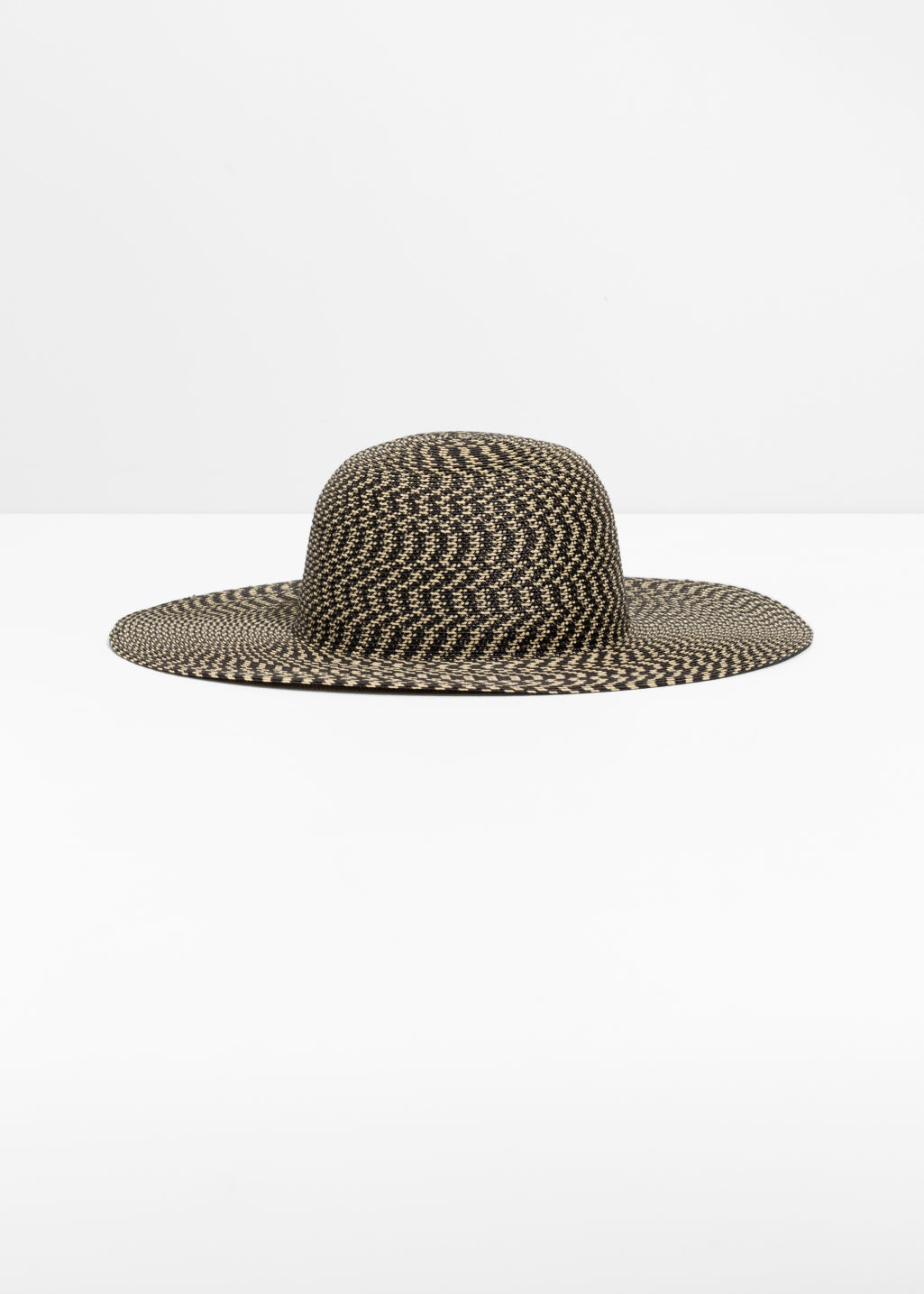 Front image of Stories wide brim straw hat in black
