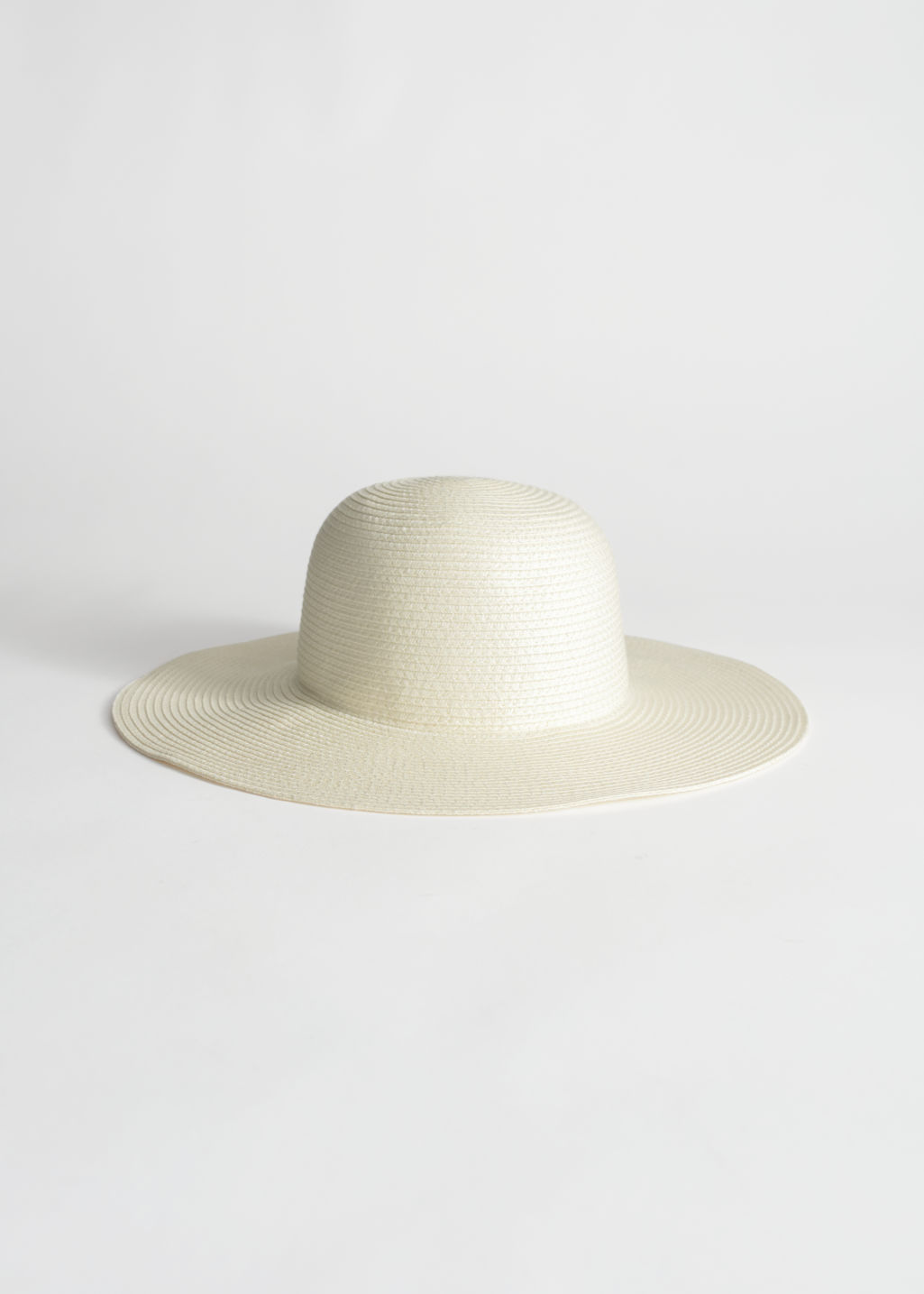 Front image of Stories wide brim straw hat in white