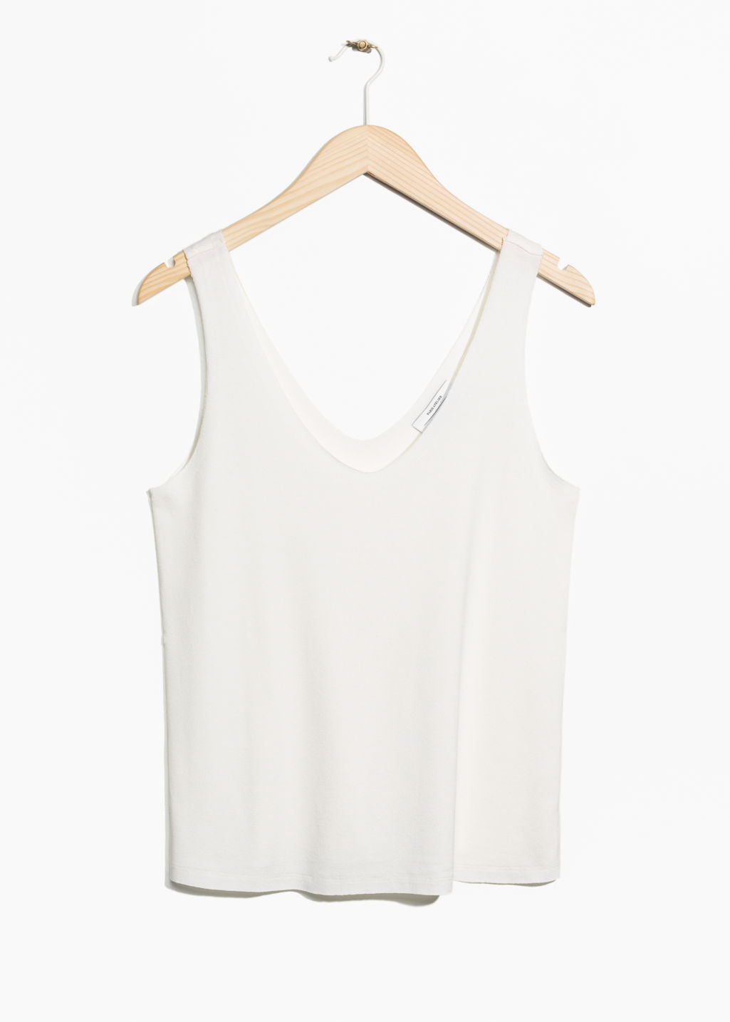 Front image of Stories v-cut top in white