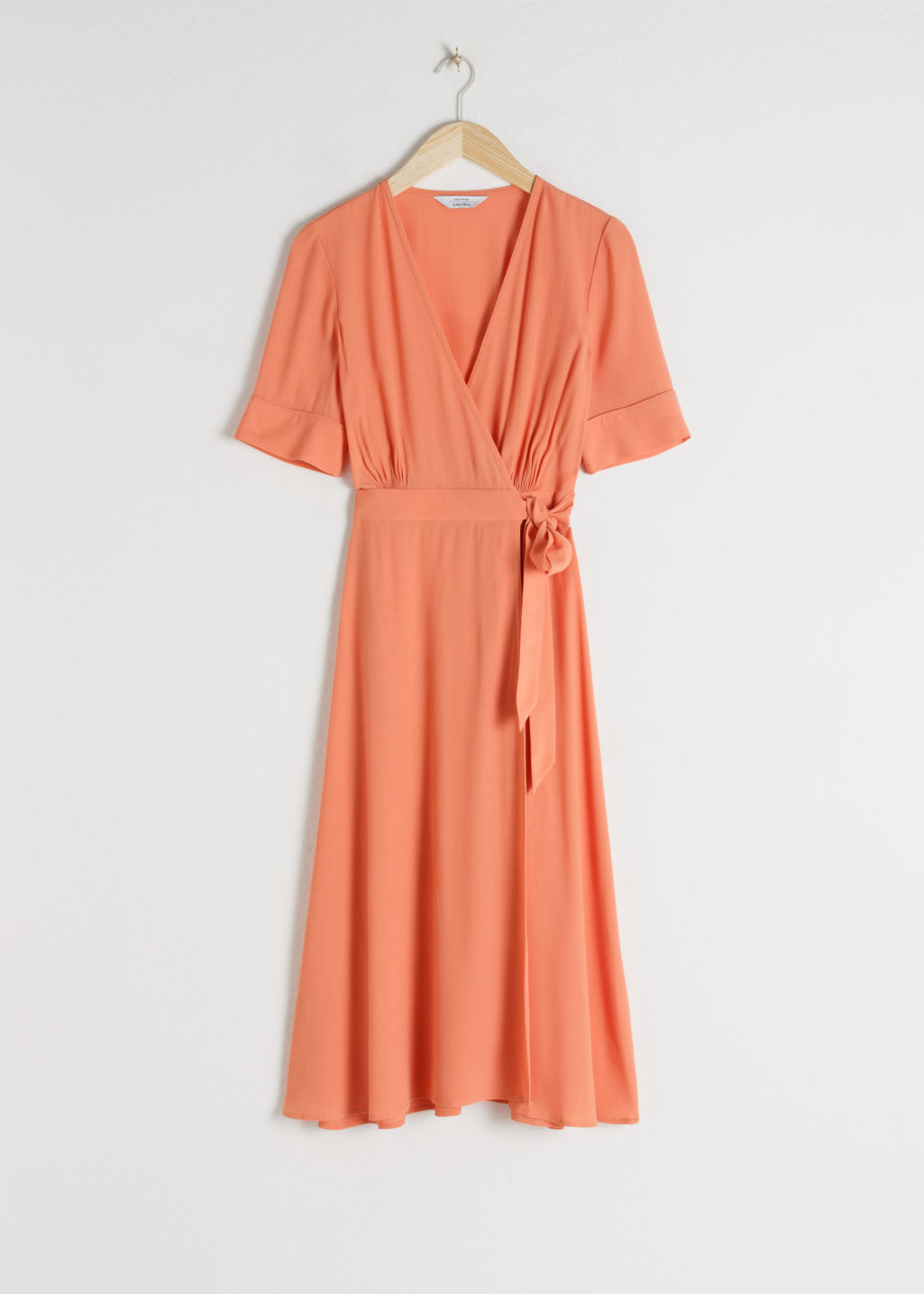 Front image of Stories midi wrap dress in orange
