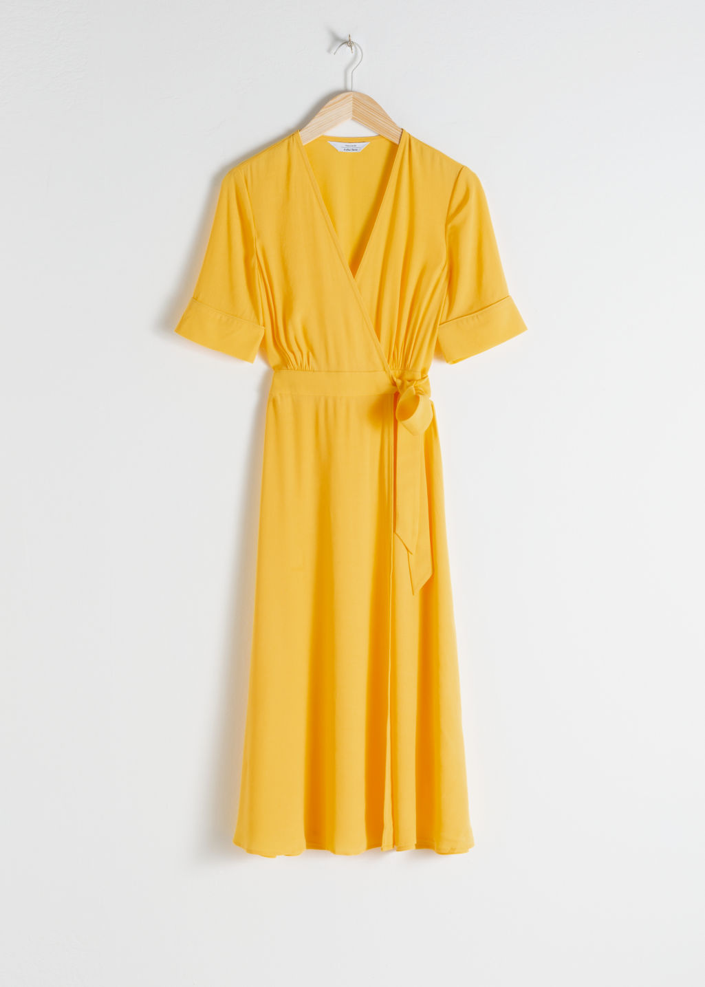 Front image of Stories midi wrap dress in yellow