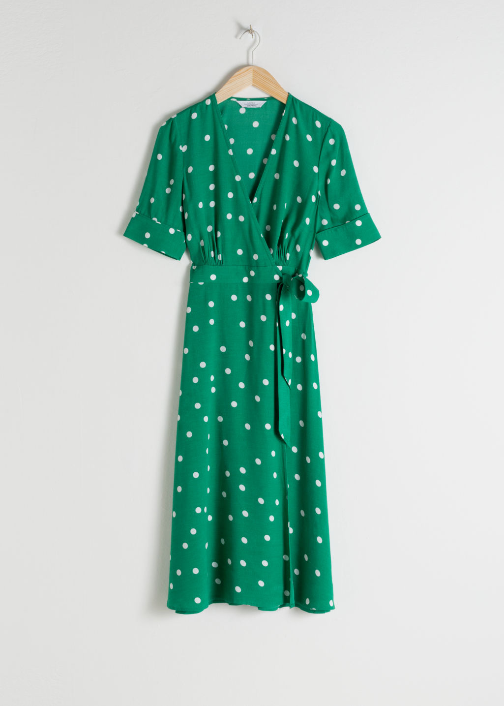 Front image of Stories midi wrap dress in green