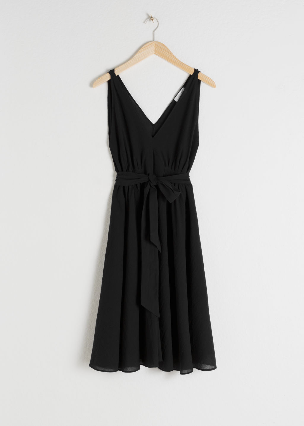 Front image of Stories v-neck dress in black