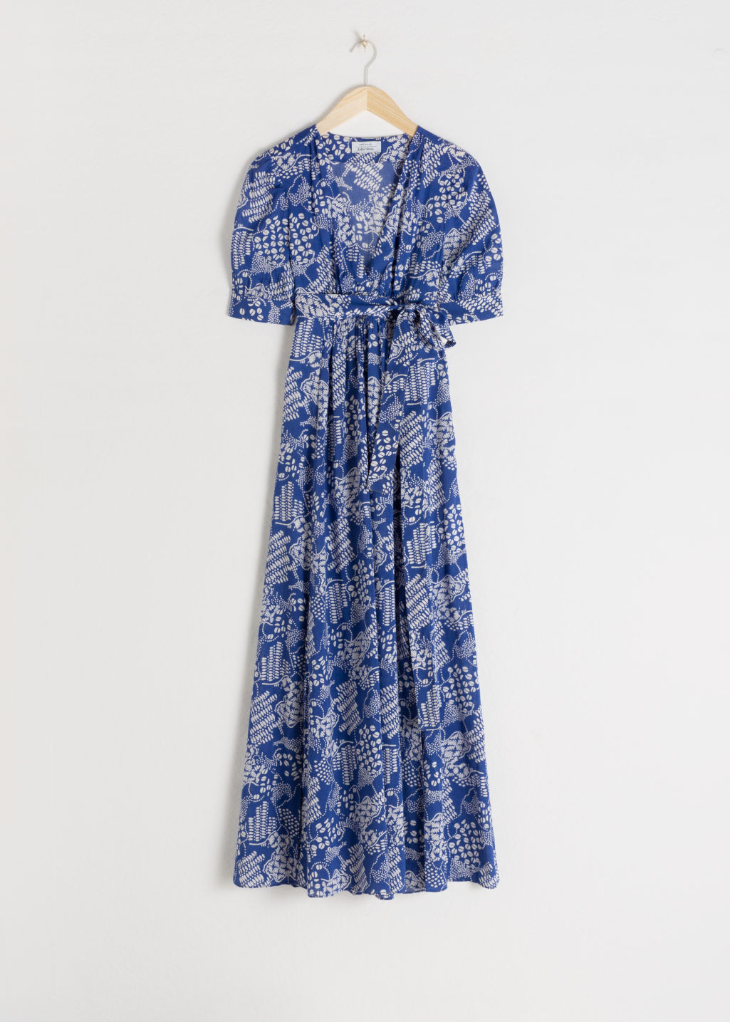 Front image of Stories floral print midi dress in blue