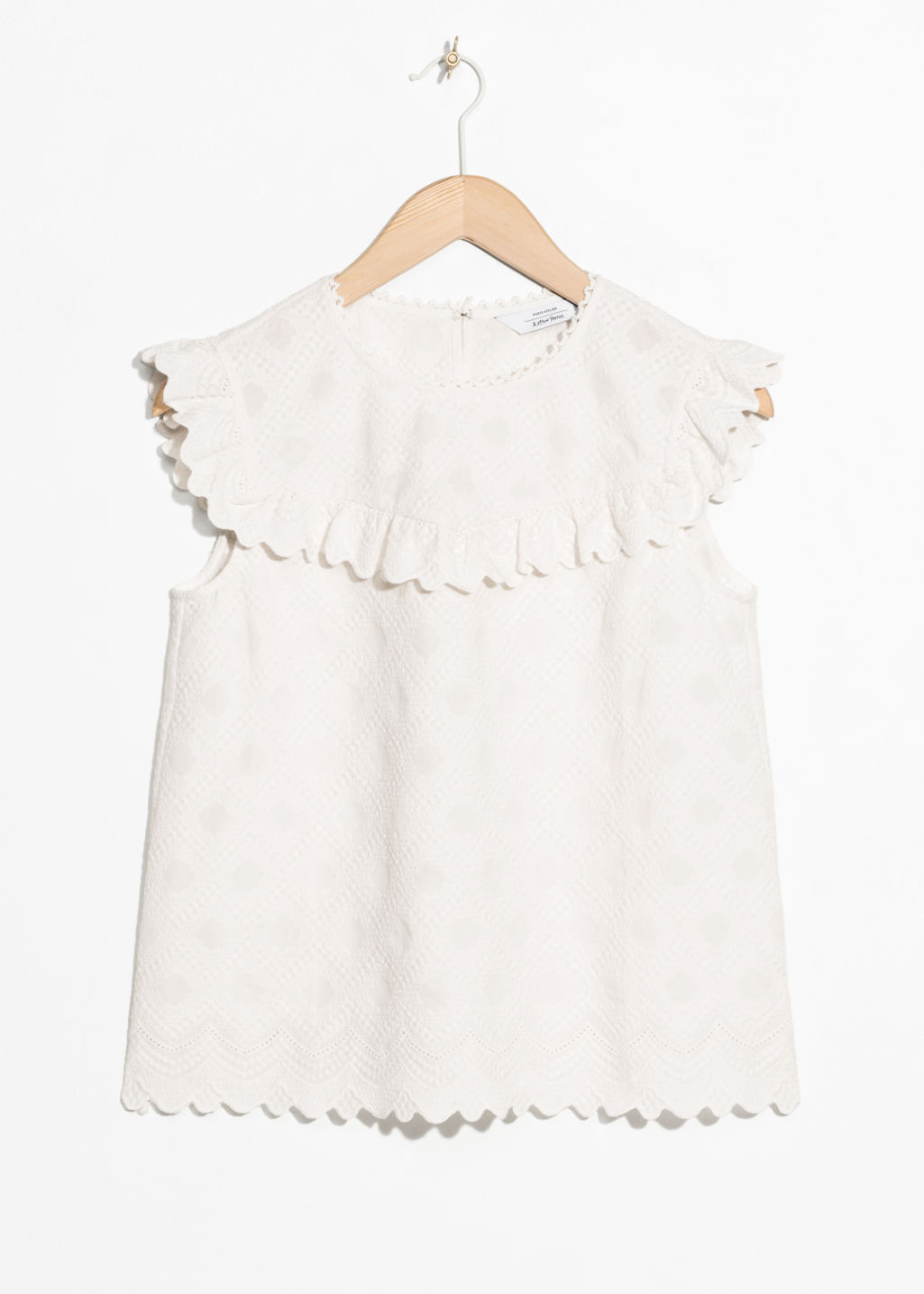 Front image of Stories frilled sleeveless top in white