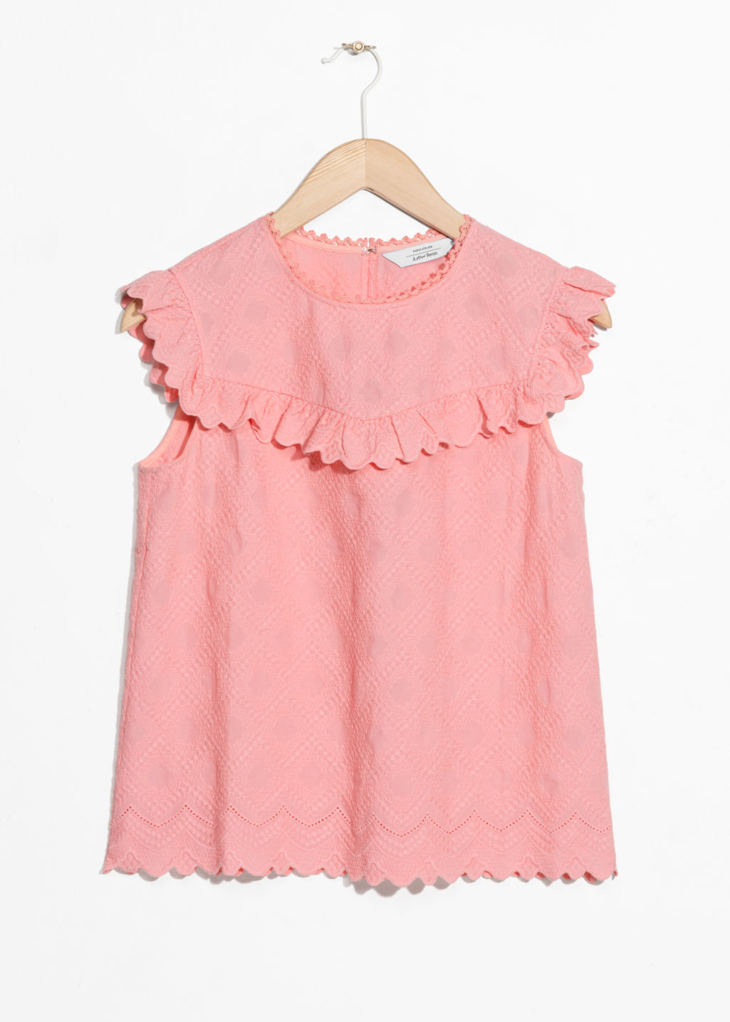 Front image of Stories frilled sleeveless top in pink