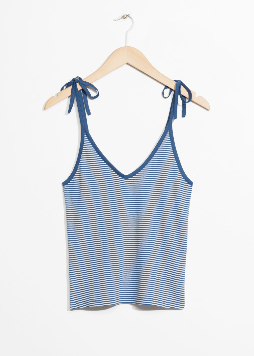 Front image of Stories spaghetti strap top in blue