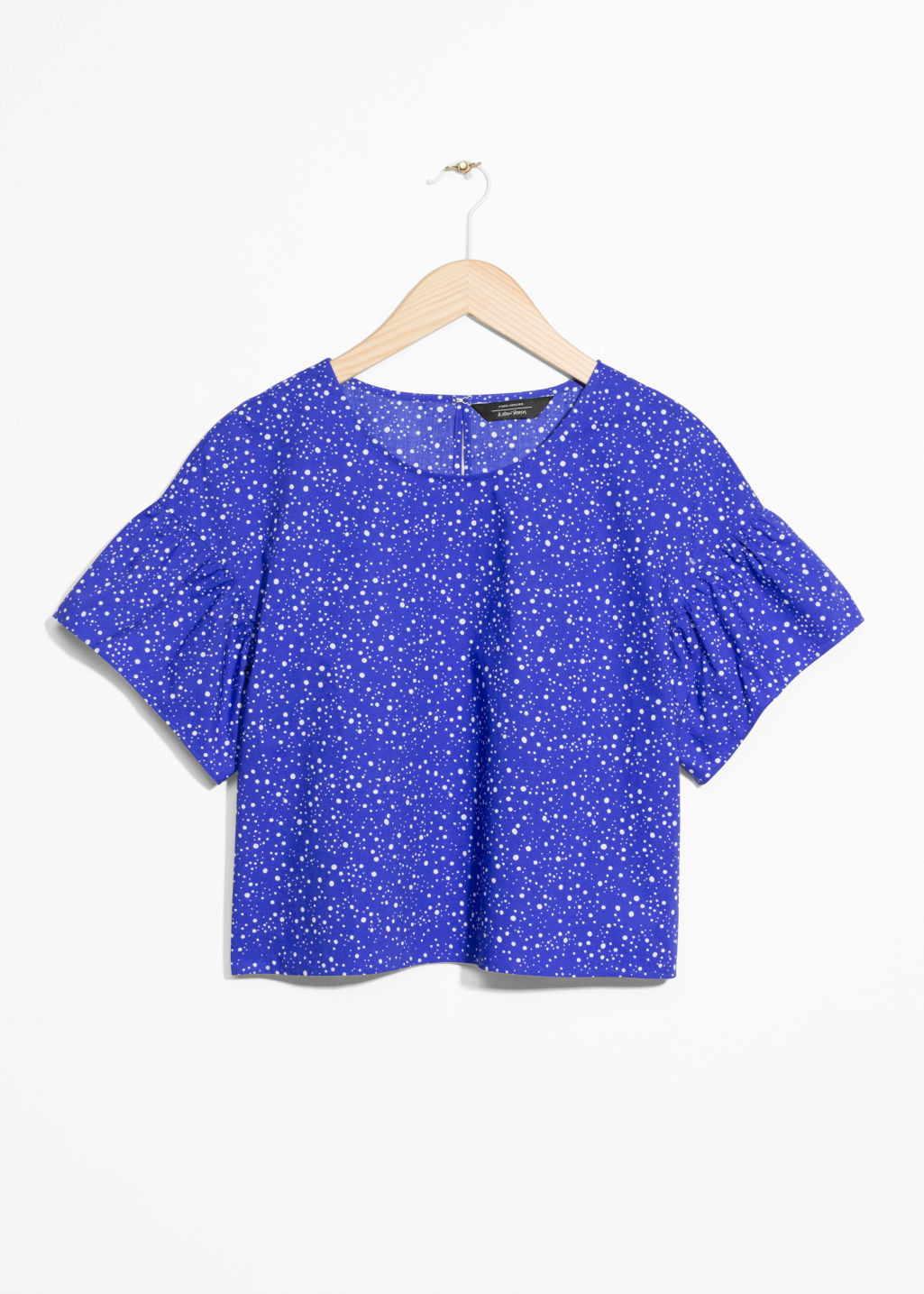 Front image of Stories crop blouse in blue