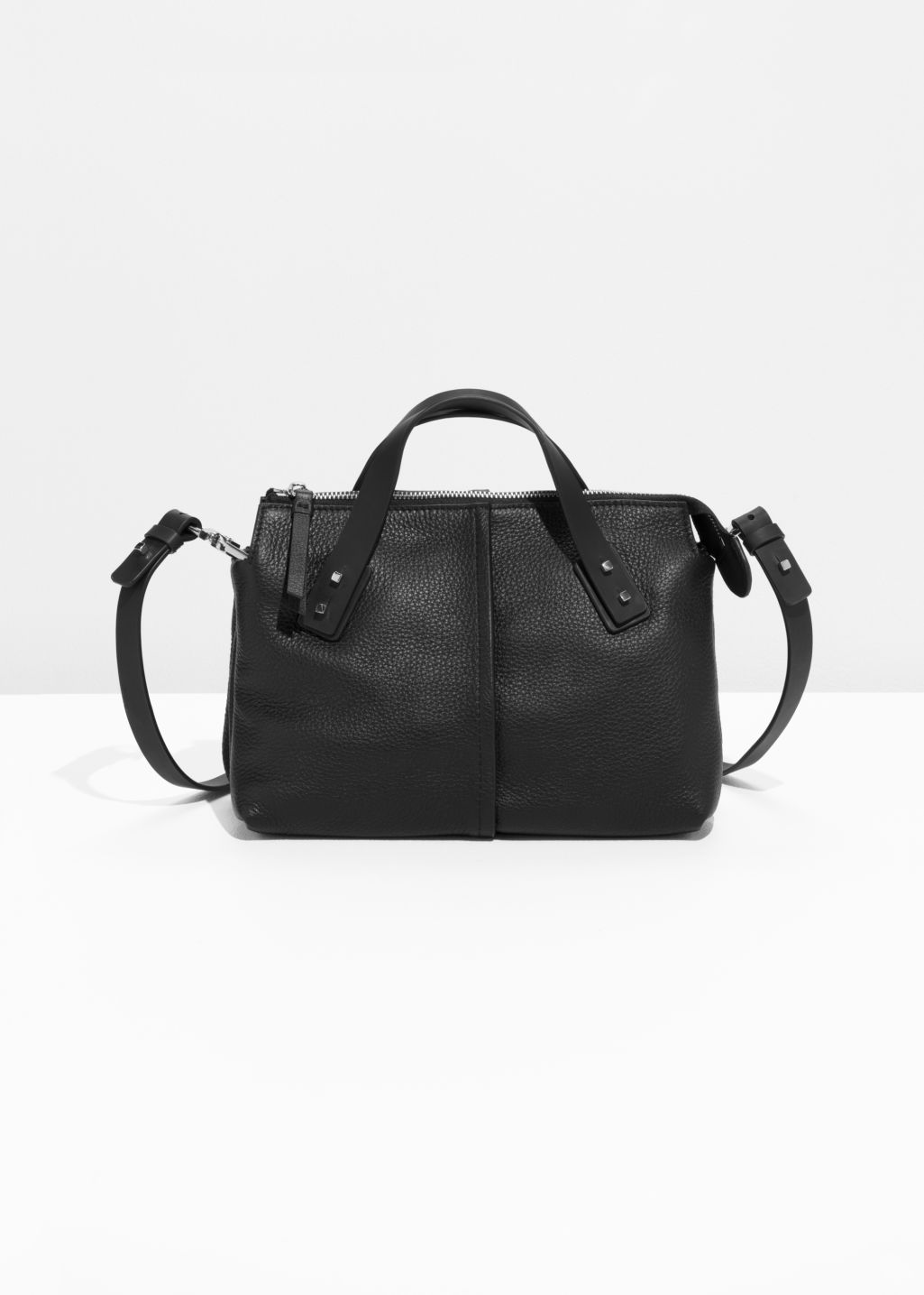 Front image of Stories grainy leather handbag in black