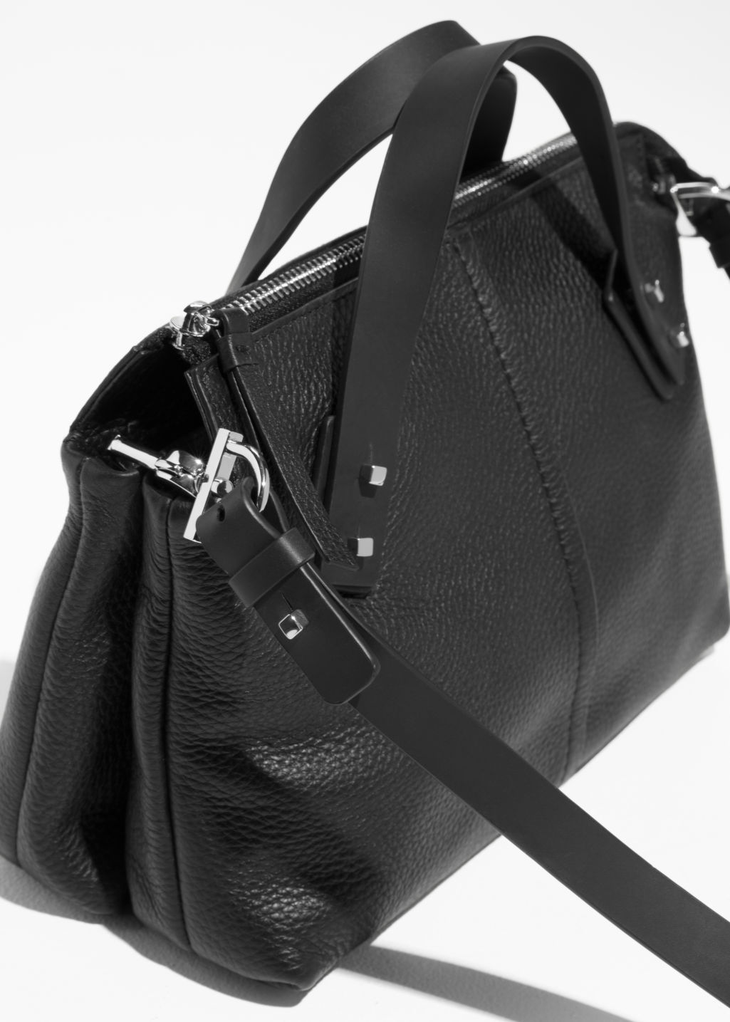 Back image of Stories grainy leather handbag in black