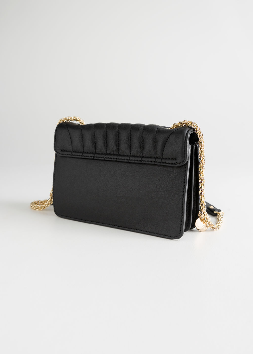 Back image of Stories gold-tone chain small leather bag in black