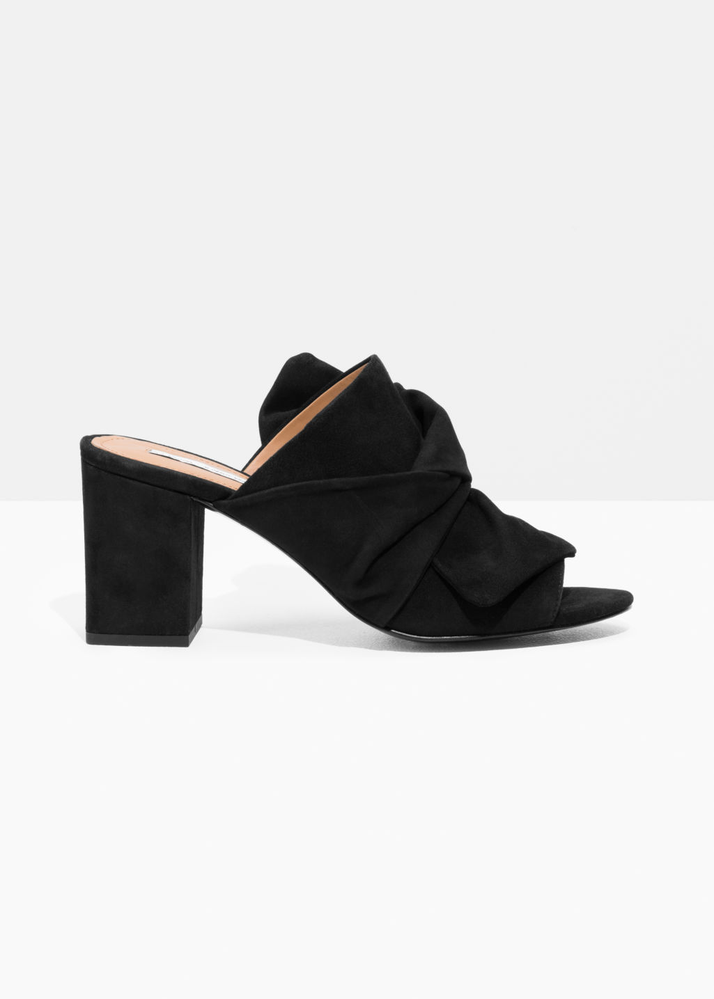 Front image of Stories bow suede mules in black