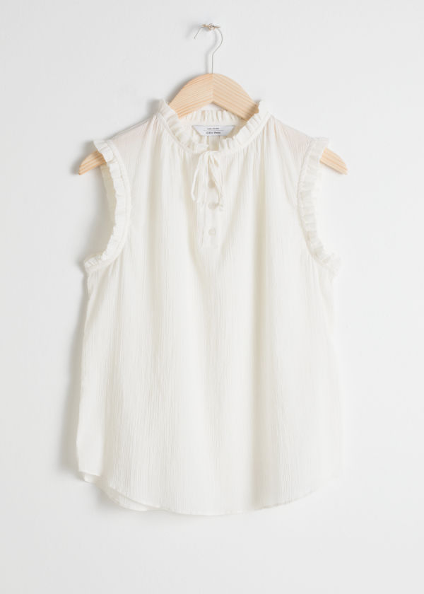 Front image of Stories frill sleeveles blouse in white