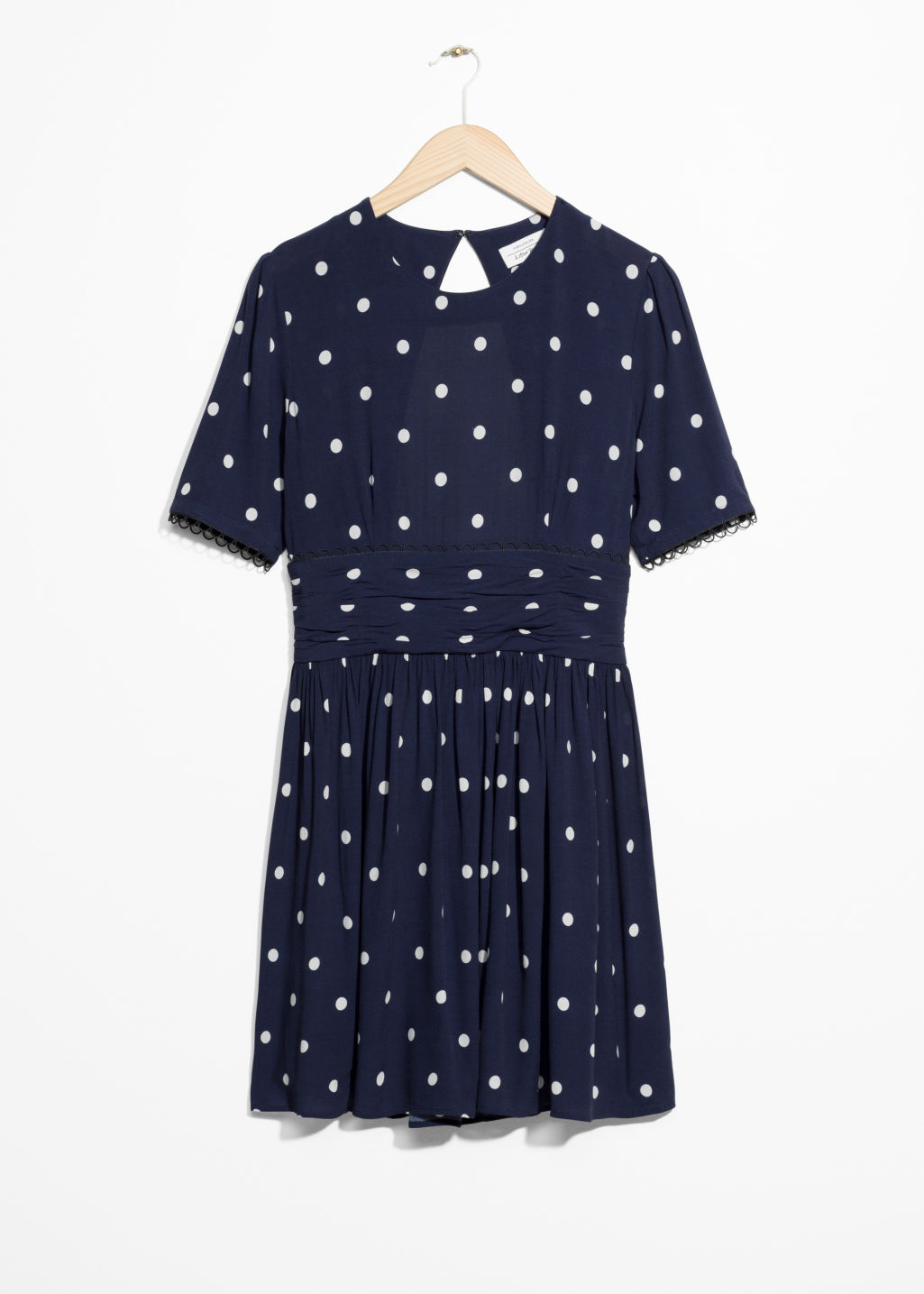 Front image of Stories dotted dress in blue