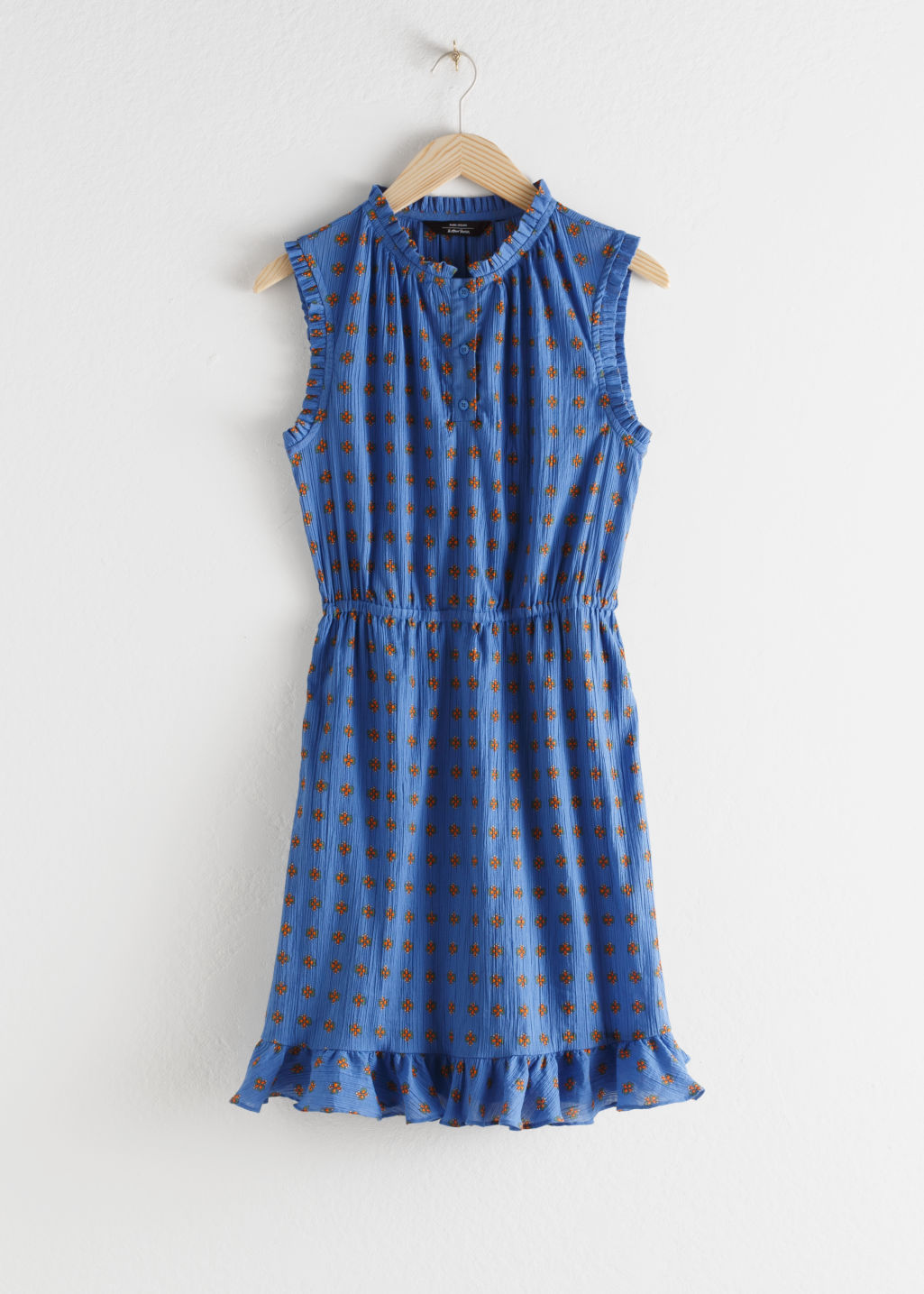 Front image of Stories sleeveless frill dress in blue