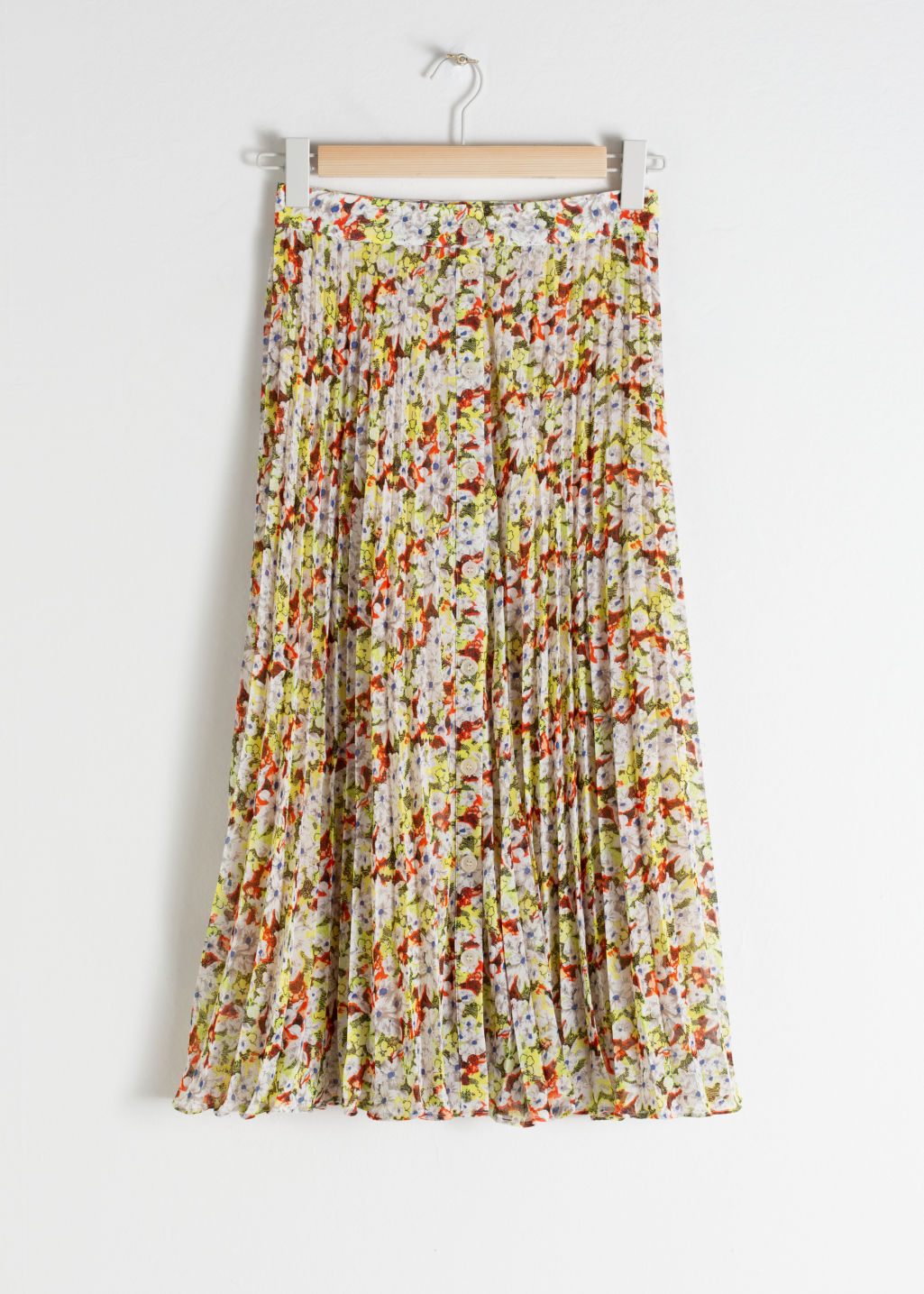 Front image of Stories pleated midi skirt in yellow