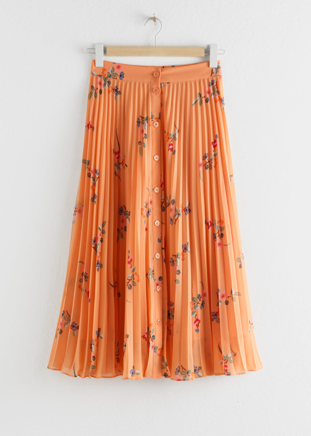 Front image of Stories pleated midi skirt in orange
