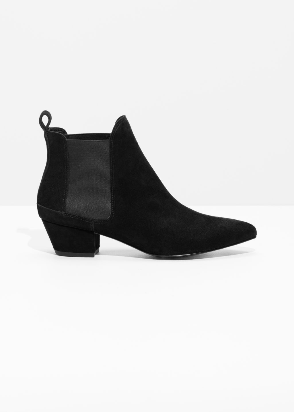 Front image of Stories suede zebra boots in black