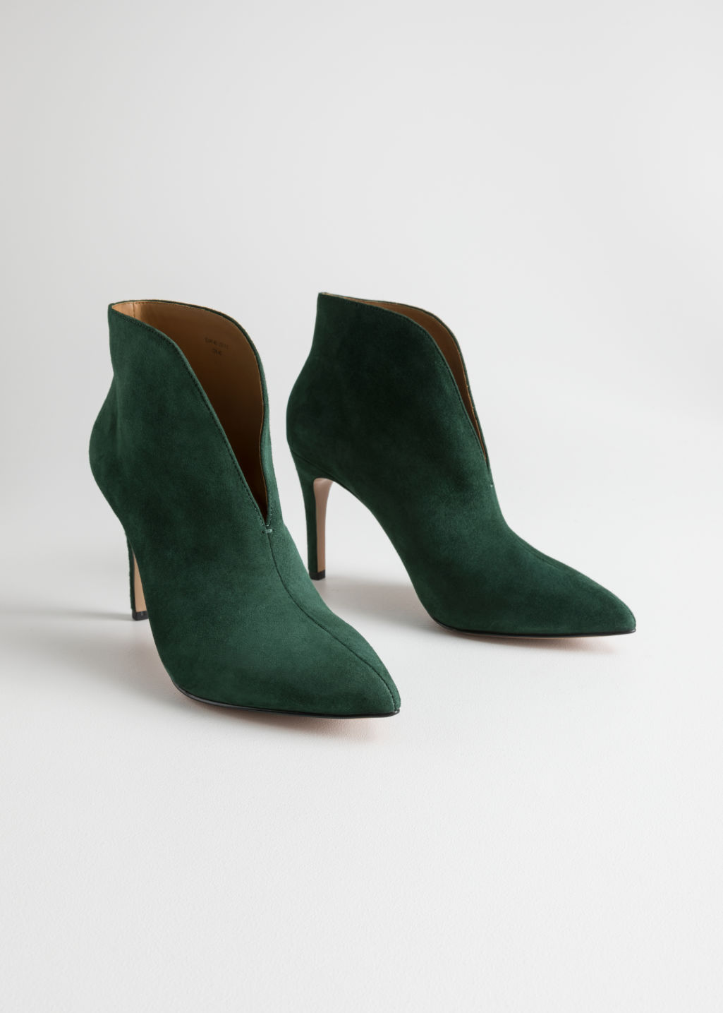 Front image of Stories front cut suede boots in green