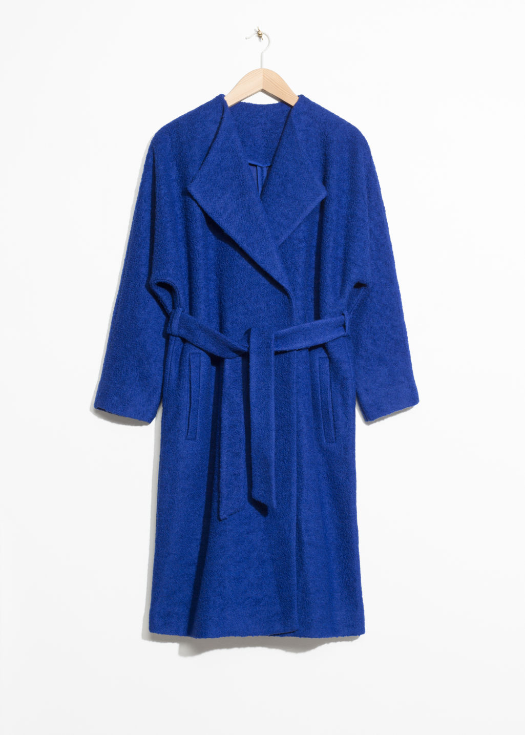 Front image of Stories oversized wool coat in blue