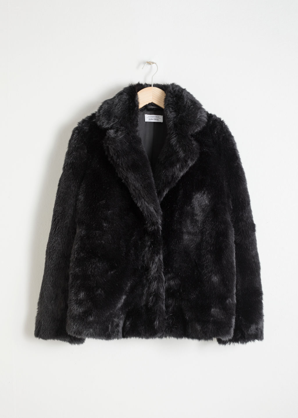 Front image of Stories faux fur jacket in black