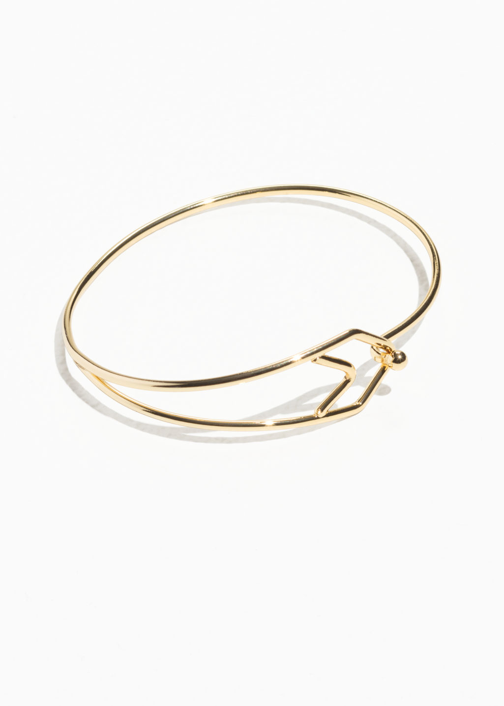 Front image of Stories double arrow cuff in gold