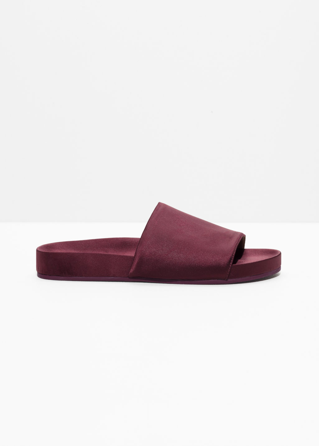 Front image of Stories satin hotel slippers in red