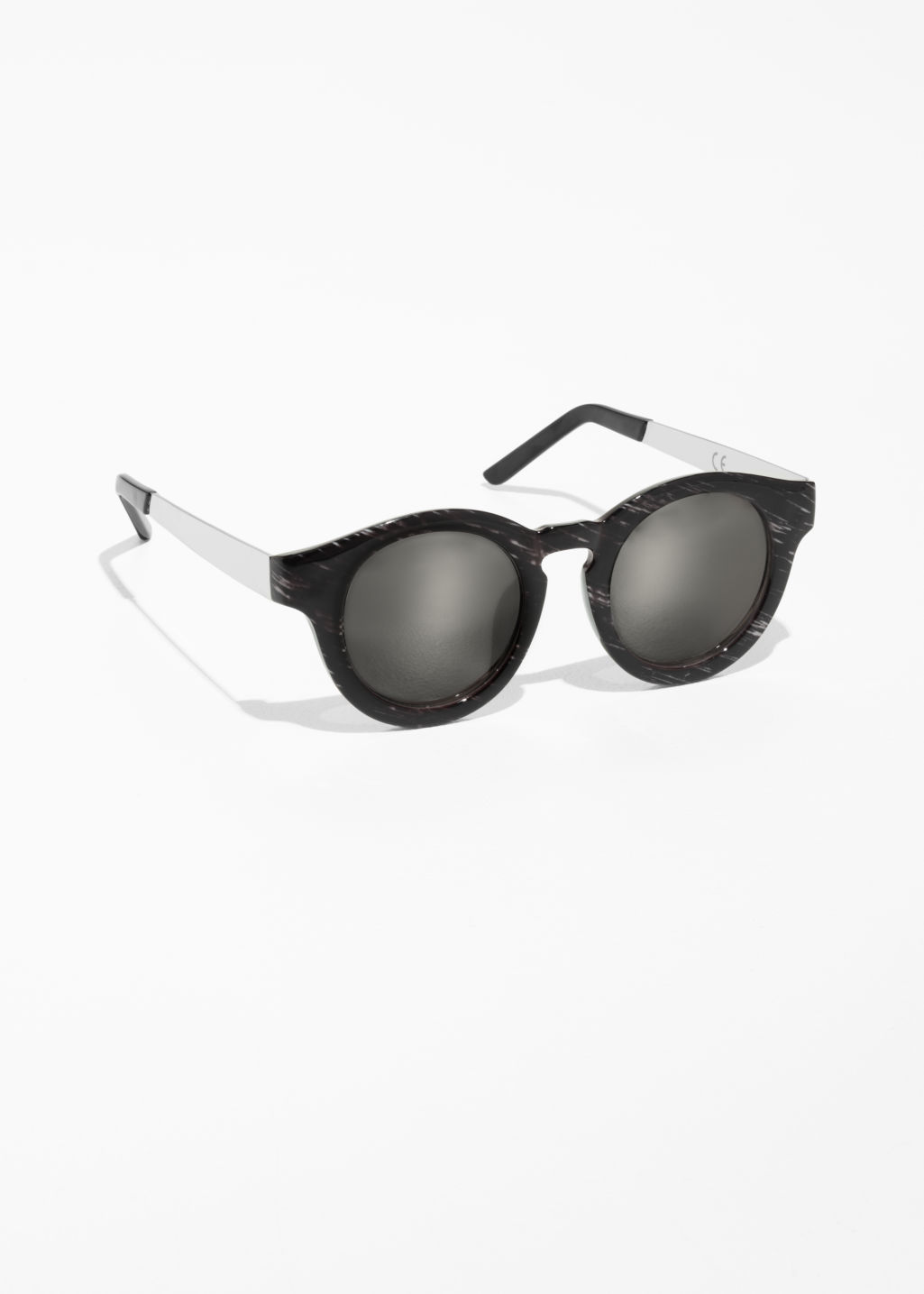 Front image of Stories mirrored round frame sunglasses in black