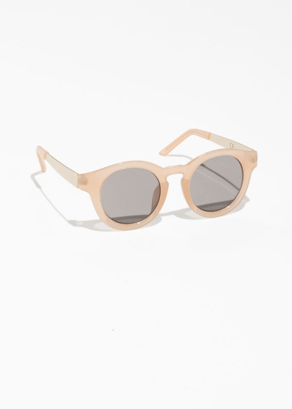 Front image of Stories mirrored round frame sunglasses in beige