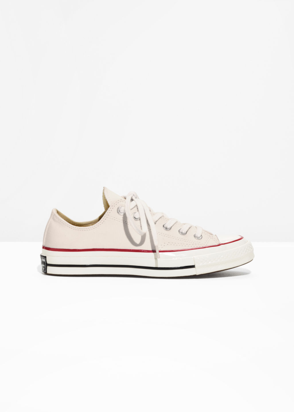 Front image of Stories chuck taylor all star 70 low in white