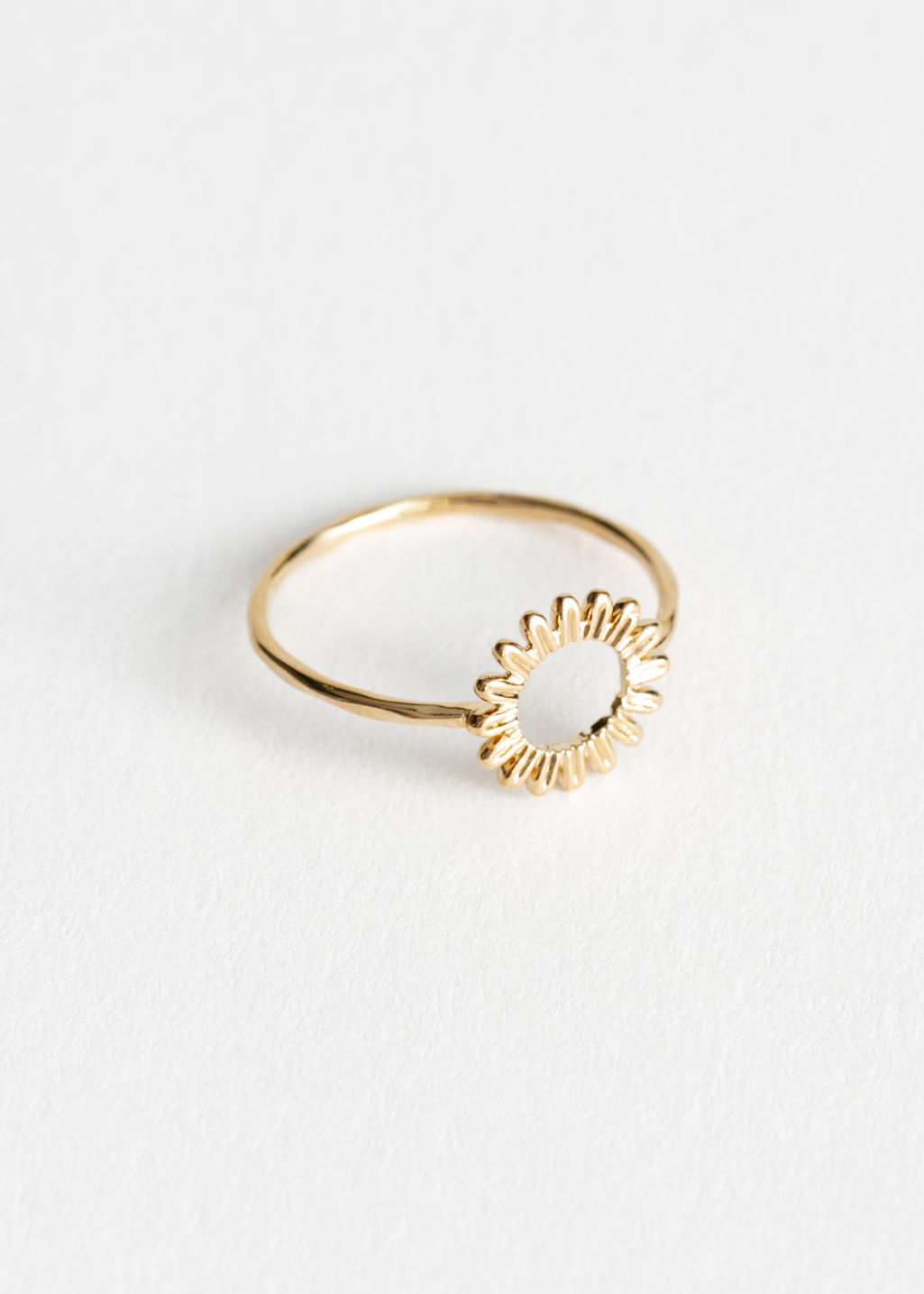Front image of Stories sunflower ring in gold