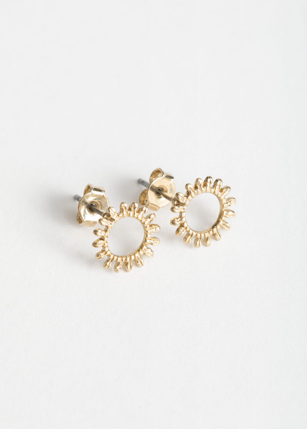 Front image of Stories sunflower studs  in gold