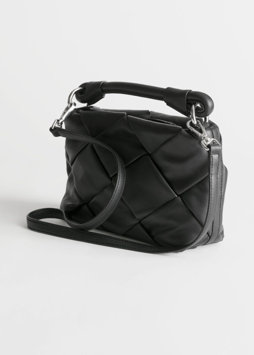 Back image of Stories braided leather crossbody in black