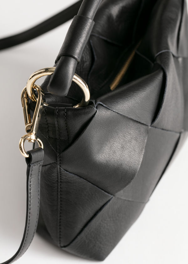 Front image of Stories braided leather crossbody in black