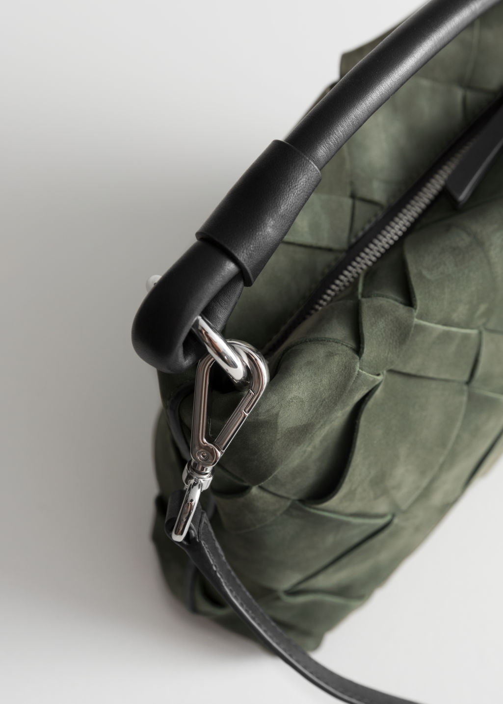 Back image of Stories braided leather crossbody in green