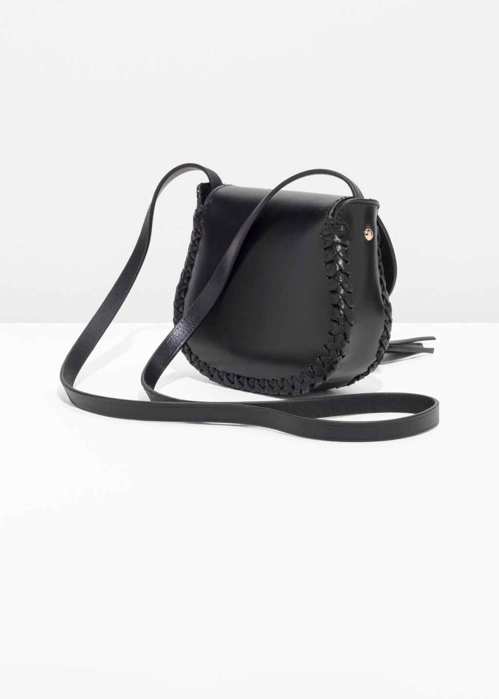 Back image of Stories ring & tassel leather mini-saddle bag in black