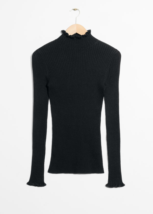 Ruffles And Ribbed Turtleneck