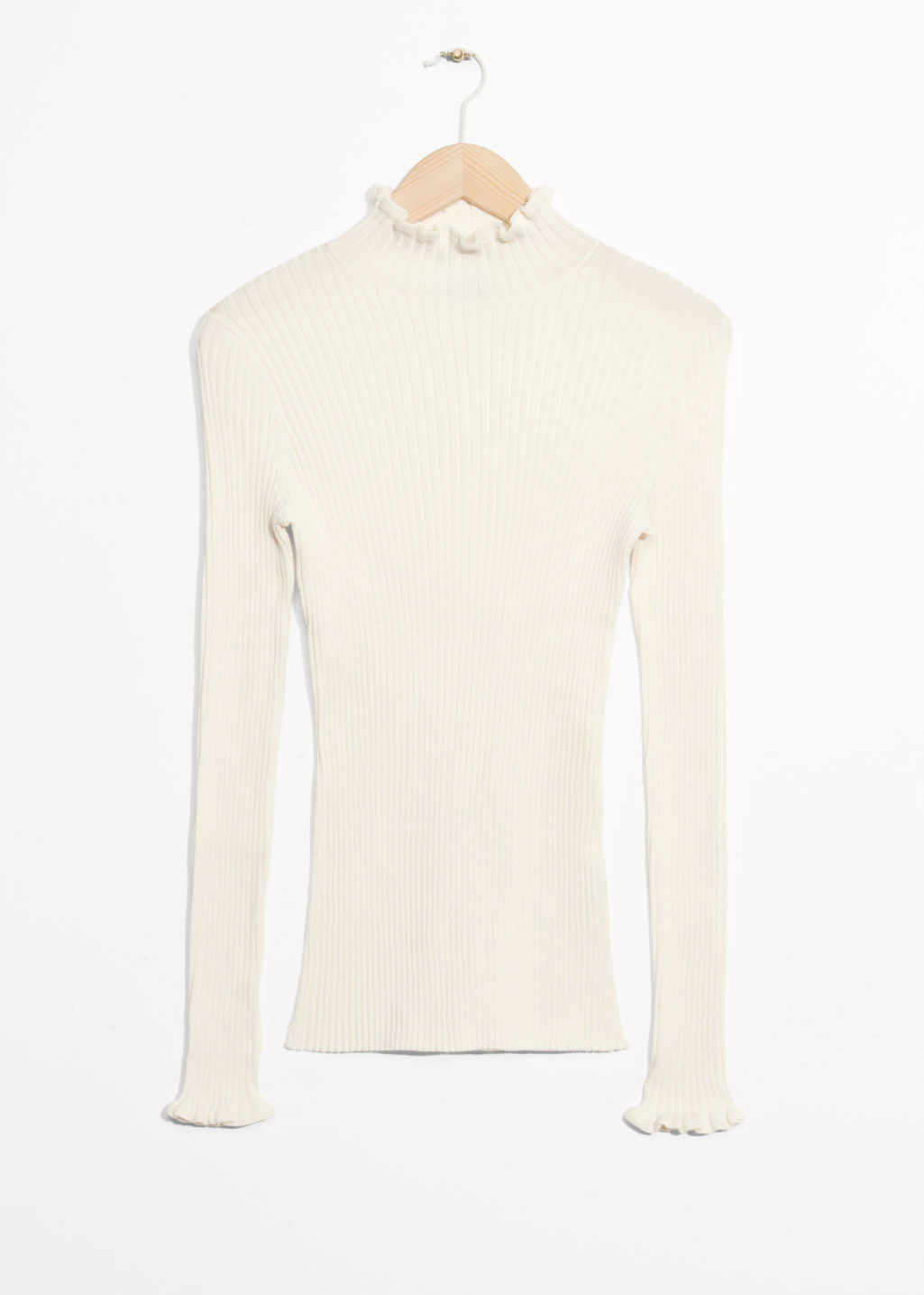 Front image of Stories ruffles and ribbed turtleneck in white
