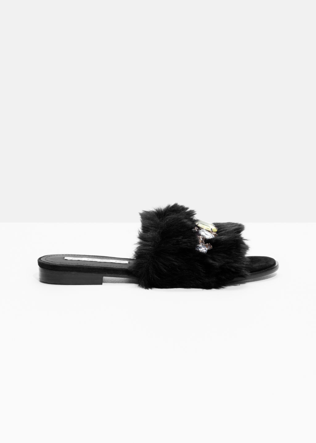 Front image of Stories gemstone faux fur slippers in black