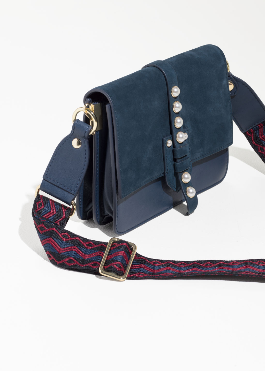 Back image of Stories ruby red stud mini bag in blue