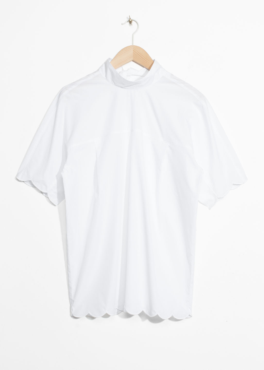 Front image of Stories scallop hem blouse in white