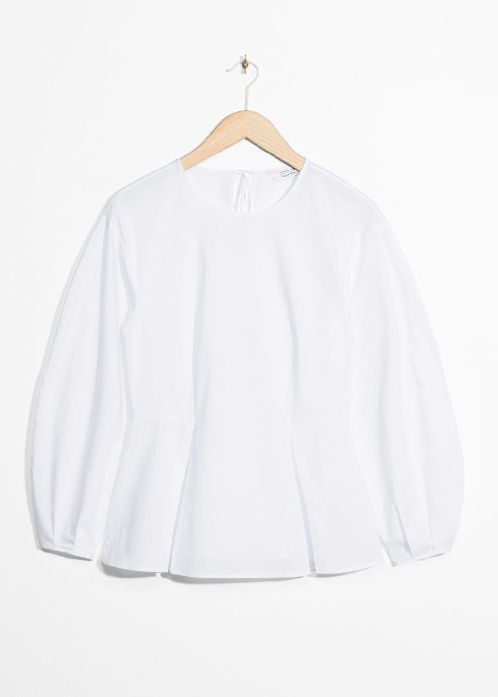 Front image of Stories puff sleeve peplum blouse in white